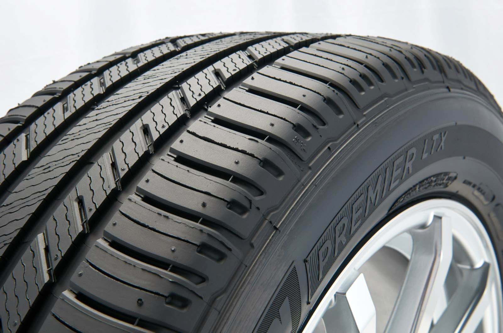 Tire treads consist of numerous design components, including sipes, grooves, blocks, nubs, pumps and more. Though the presence and name of tread components vary widely between tire manufacturers and types of tires, the common ones are visible above.</p> <p>Sipes are the thin cuts, most prominent on the middle part of this tire's tread. These thin slices are typically designed to force water away from the surface of the tire to prevent hydroplaning, or to give a thin film of water a place to go when tires roll over it. It's all about enhancing the amount of rubber touching the road. Sipes also play a role in determining the flexibility of a tire, which affects its handling and noise levels, too.