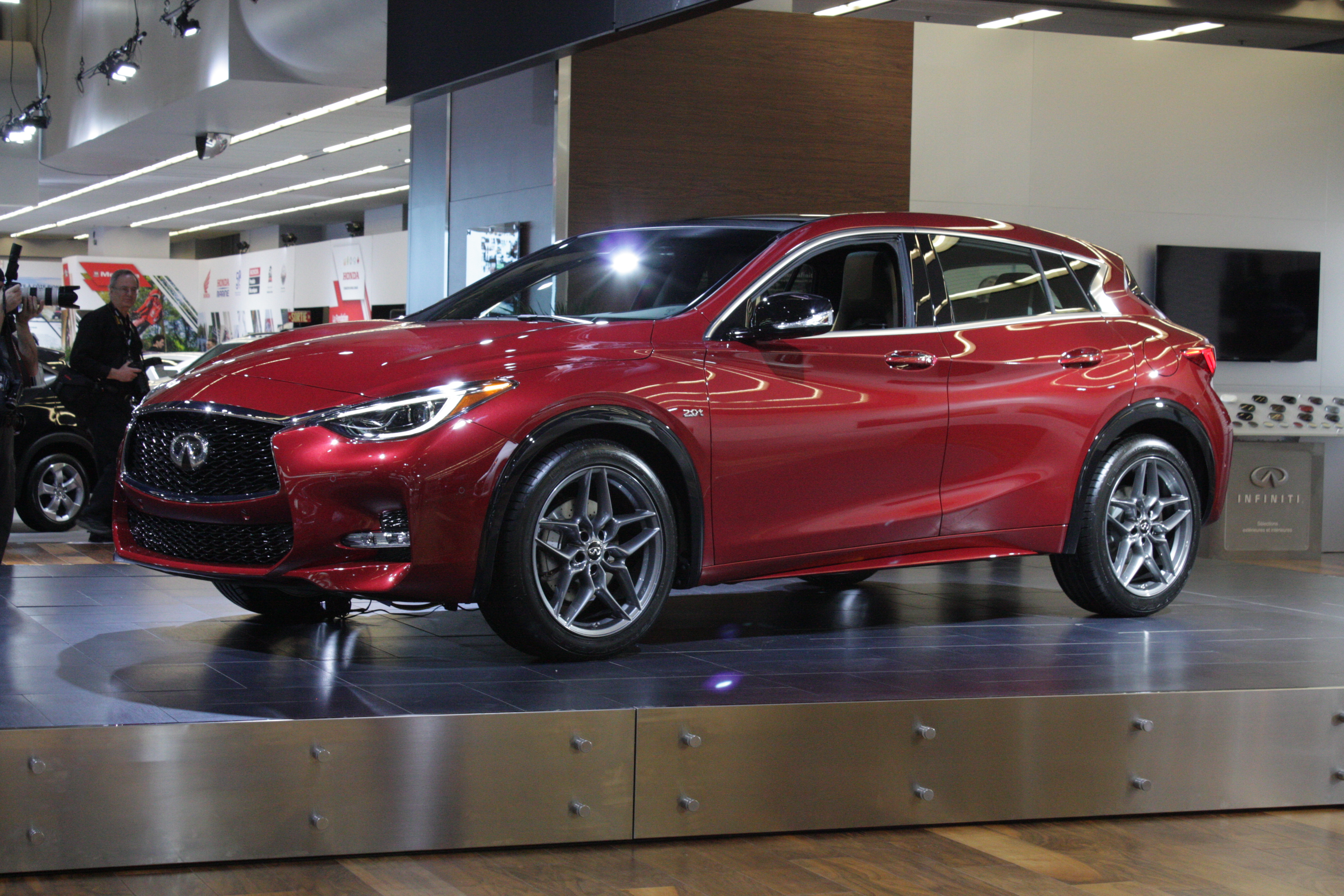 Infiniti's highlight was its QX30, a new compact hatchback available in a low-slung front-drive version...