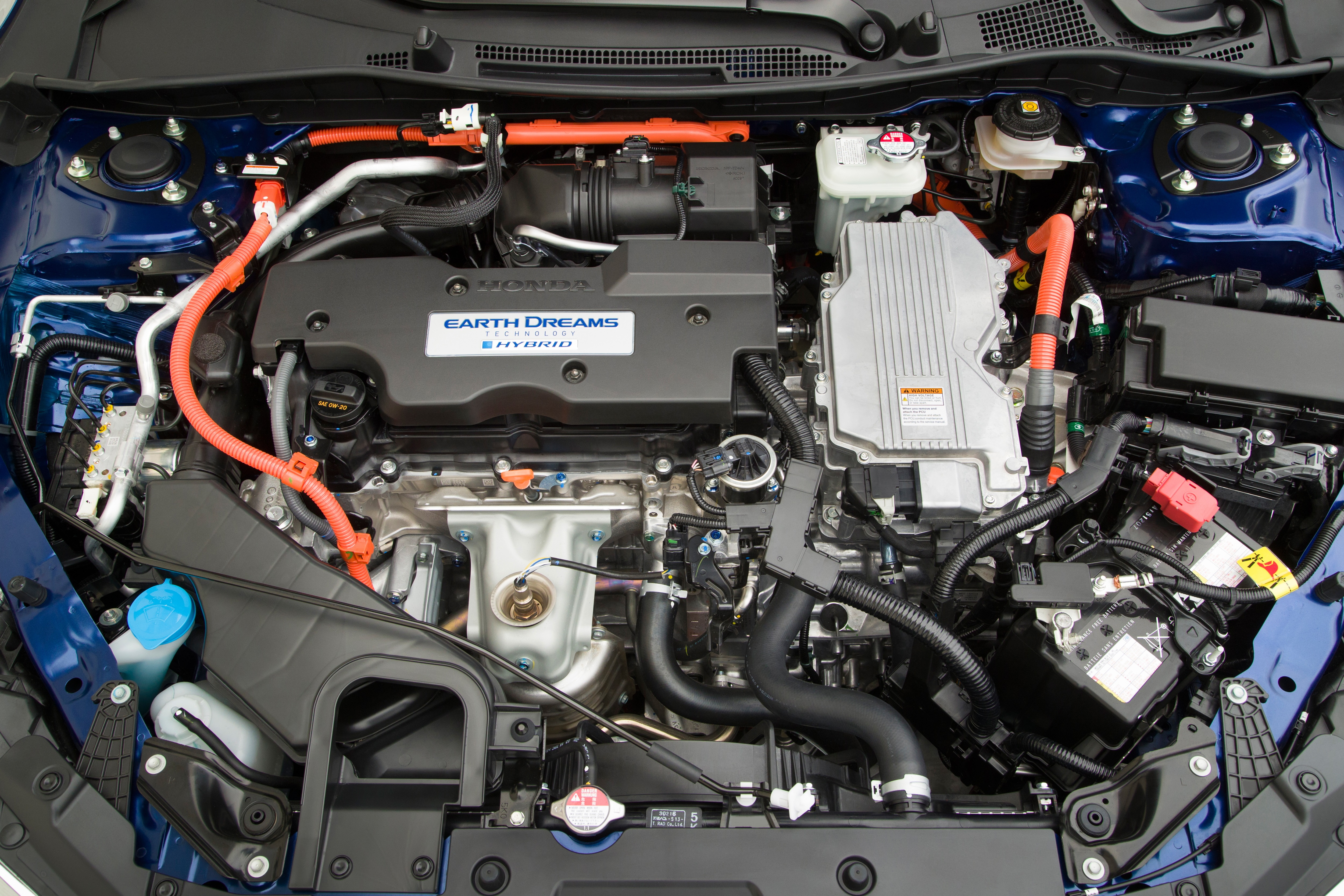The power control unit is the silver-coloured device next to the engine.