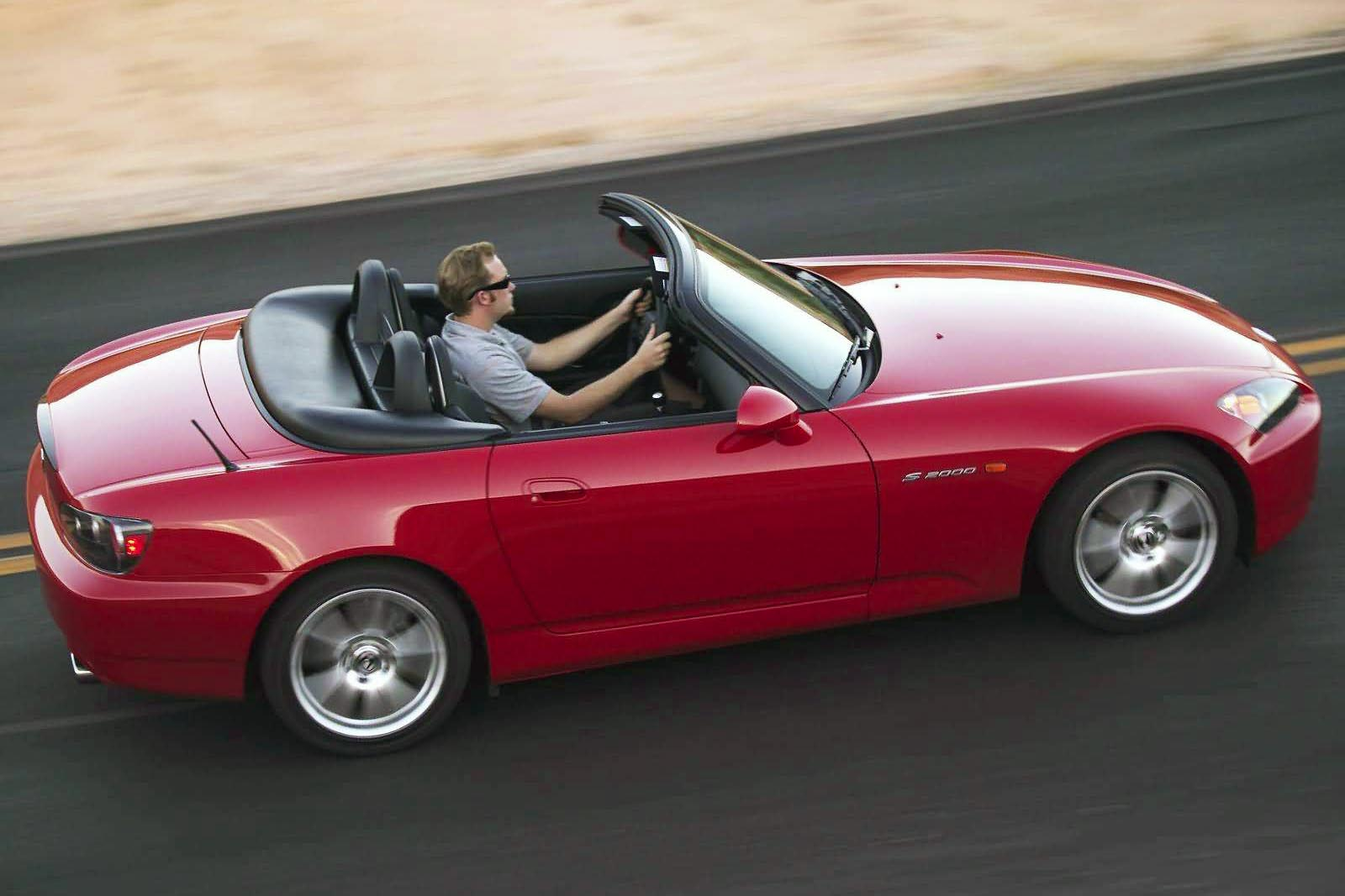 Another of Honda's VTEC-equipped playthings, the S2000 is no longer with us, but it remains a popular used roadster buy. Mainly, that's because you get a high-strung four-cylinder engine that loves to scream, frisky-pants handling, grip for days, and a slick, stubby and short six-speed manual transmission as the only gear-shifting option. As a pure drivers car should be, this one makes you work for your thrills, and it's worth every bit of effort.