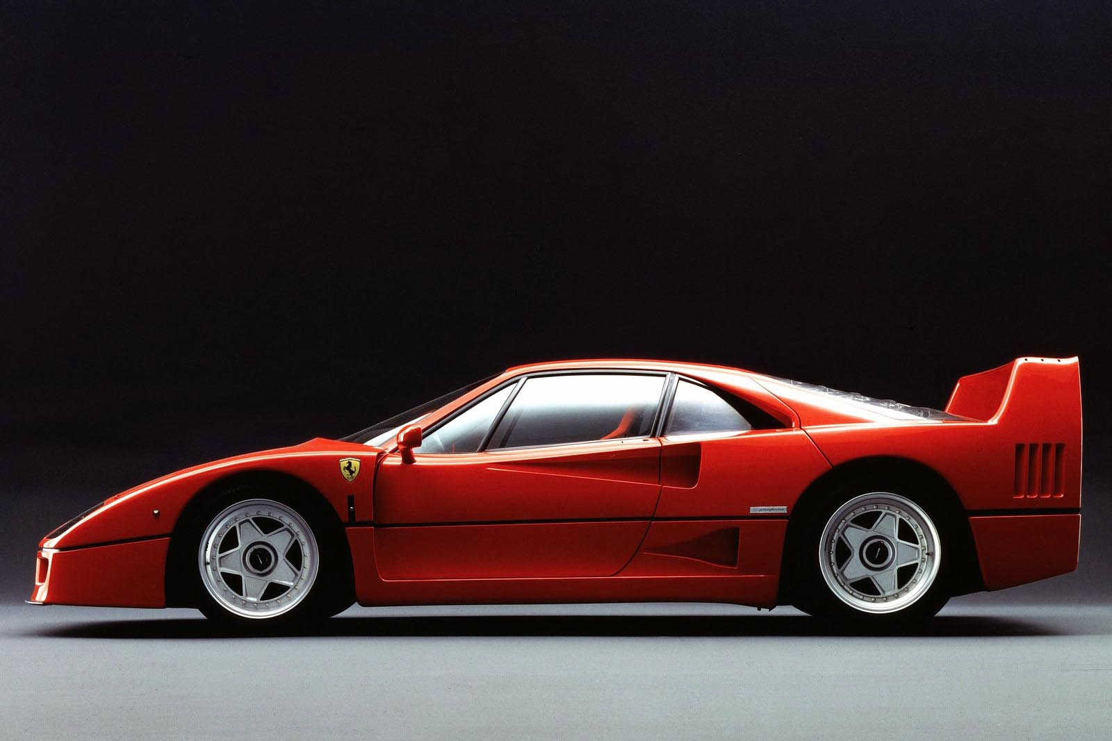 Dear Ferrari: thanks for being Italian, being pretty sweet, and making cars we listen to on YouTube when the boss is distracted by the Keurig for a latte refill. Thanks, also, for the F40. We love its little boosted V8, how the exhaust sounds like a Velociraptor's mating call, and the mental image of ripping through its gears like Christmas-morning wrapping paper. Still said to be the world's best supercar, we're glad this machine helped set the stage for the great supercars that we lust after today.