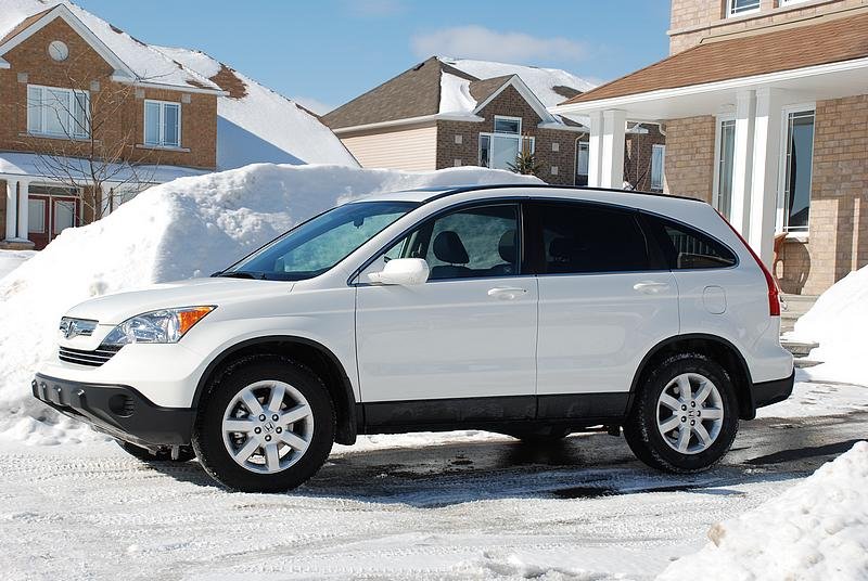 Hot on the Ford's heels in sales volume, Honda's CR-V is a ubiquitous sight in the school parking lot. Figure a 2008 or 2009 model will be within budget, and then it's down to trim levels.