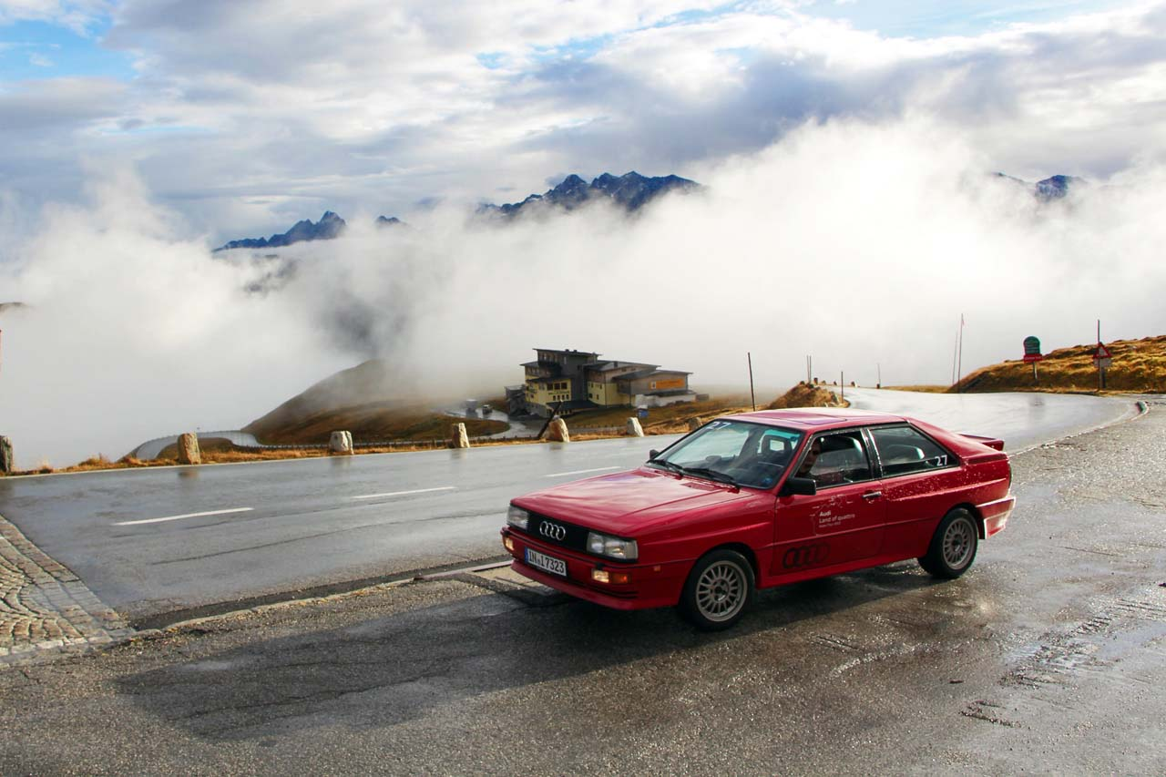 """When the rules of rally-racing changed to allow four-wheel-drive vehicles to participate, Audi was first to respond. Their car, sometimes known as the Ur-Quattro (<i>Ur</i> for first or original), simply dominated right out of the gate, beating up on the competition with turbocharged power and excellent traction. Other manufacturers were quick to respond, but Audi enjoyed two full years at the top thanks to their technological leap. Even today """"Quattro"""" is still proudly emblazoned on the best and fastest machines they make."""