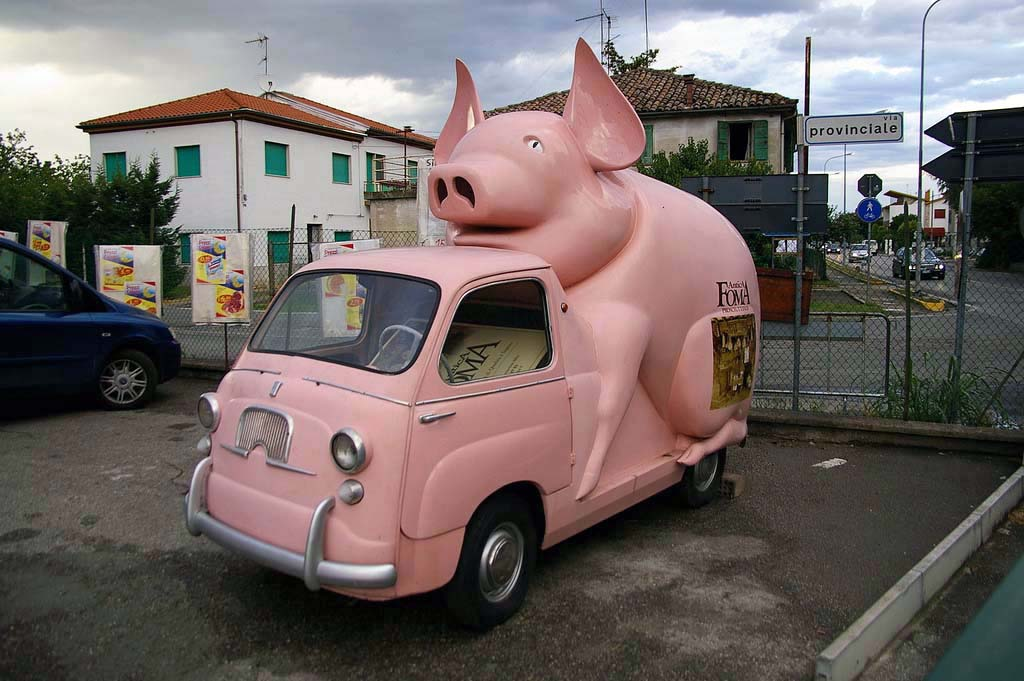 While we're on the pig bandwagon, here is our runner-up in the pig truck category, though this one was simply a Fiat Multipla converted to advertising vehicle to promote chicken. Just kidding, it was to promote ham, or perhaps for an animal feed company. But really, who cares, what is that pig doing to the poor vehicle?