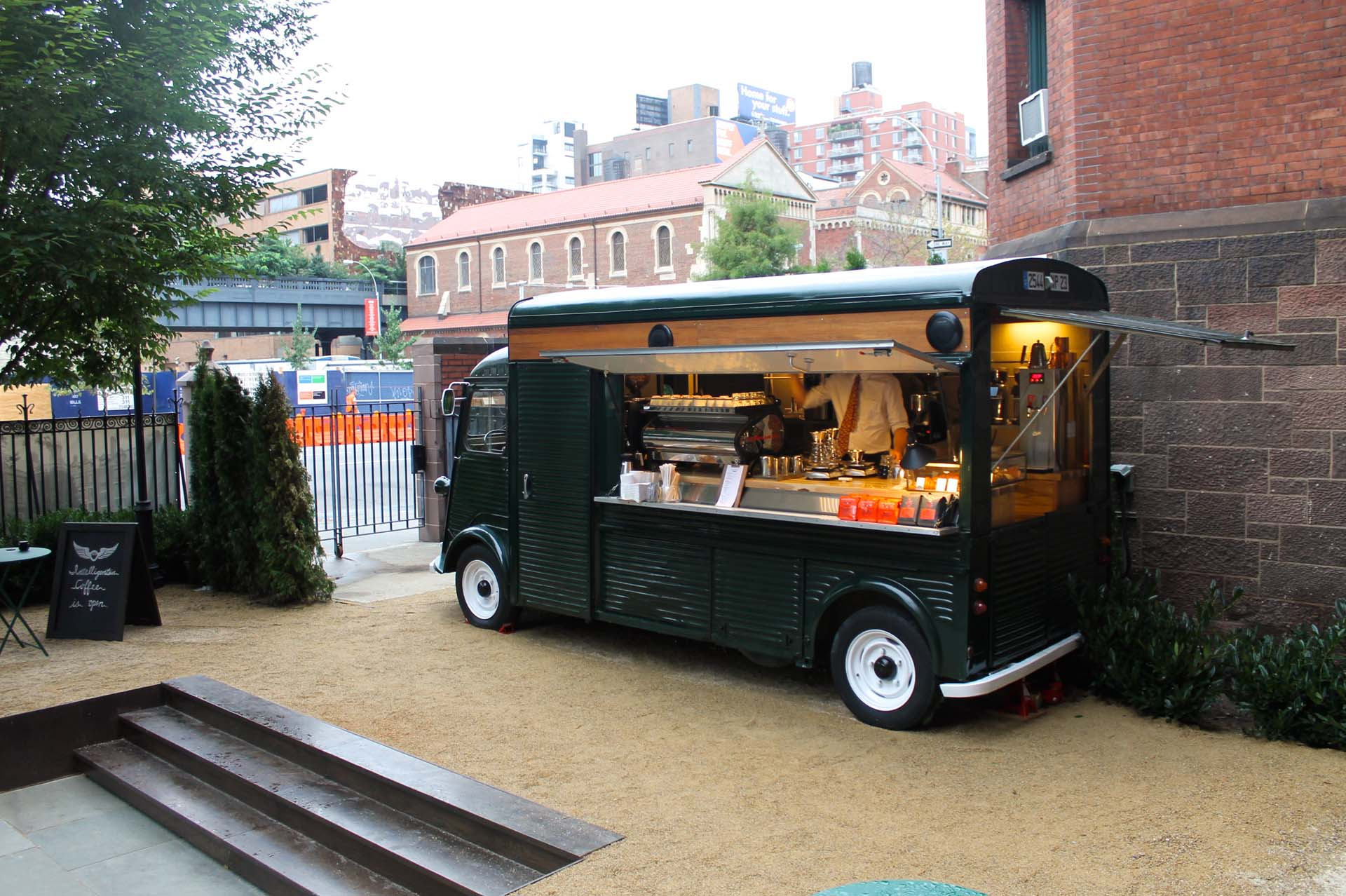 While not as crazy as a giant, pig-shaped truck, Intelligentsia scores big points for fitting into its environment, hip, trendy downtown Manhattan, serving up coffee just outside the swank High Line Hotel at the corner of 10<sup>th</sup> Ave and 20<sup>th</sup> St. Starting with a 1967 Citroen HY Van, its designers retrofitted the interior to house a full barista bar and service counter. And painted it black, of course.