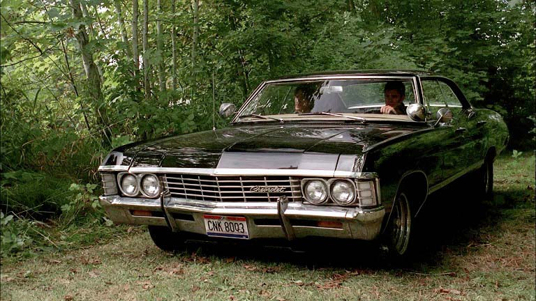 """This series has inspired intensely loyal fans, who consider the 67 Chrysler Impala in Supernatural almost as strong a character as the humans. It doesn't have any special abilities, other than to take a beating and keep going (hey, think a Smart car could chase after this many demons and survive?). This model is almost 50 years old now. As ever, time's judgement has been accurate and merciless: car models, like books and paintings, come to be seen as either totally forgettable or cherished classics. Certainly, this car falls in the latter category. So is that why it was chosen, because it carries a certain je ne sais quoi? Uh, no. The creator of the series says they wanted a big car so that """"you can fit a body in the trunk."""" Moving on..."""