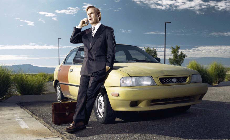 """In Breaking Bad, stylish barrister Saul Goodman makes an impression by cruising around in a sleek Cadillac DeVille. However, in this series, which serves as a prequel, Saul is just starting out -- in fact, he hasn't acquired either the Cadillac or the name """"Saul Goodman."""" Instead, struggling public defender Jimmy McGill struggles to make it from point A to point B in a run-down Suzuki Esteem, complete with mismatched rear door. A couple of things bear mentioning. First, the name """"esteem"""" is highly ironic here. Second, it will be interesting if this show can make something of an icon of the car, which suffered from such poor sales it helped persuade Suzuki to pull out of the North American automobile market entirely."""