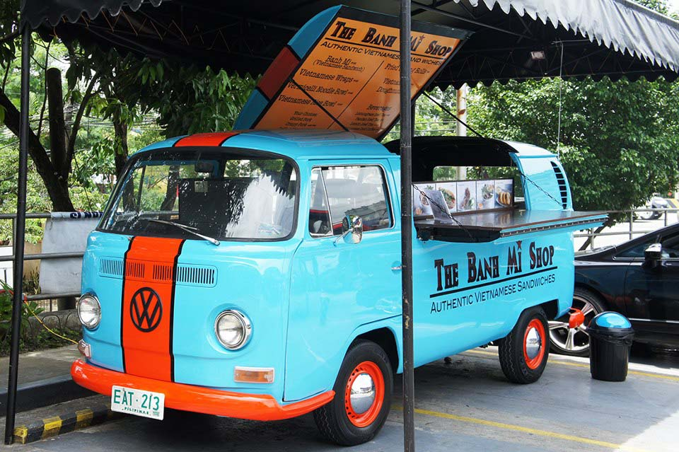 And because we have a fetish for converted old Euro-delivery trucks, this vintage VW Bus gets treated to a slick paint job with one of our favourite racing liveries (Gulf blue and orange) while serving delectable Banh Mi sandwiches and other Vietnamese delicacies in Quezon City, Philippines.