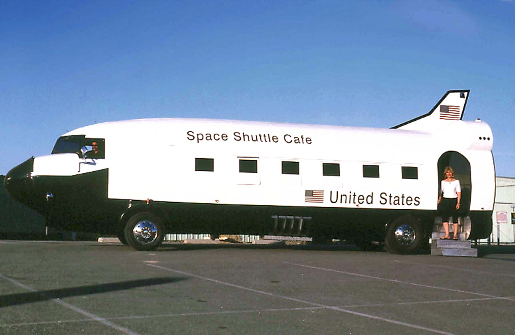 This food truck is just out of this world. That was horrible. A truly awful cliché. But c'mon, cut me some slack, when will I ever get to use a line like that again? Anyhow, this Space Shuttle Café is actually based on a converted airplane. It was originally a Douglas DC3 that actually saw military service during WWII, served many years as a commercial airliner, was converted to a camper on wheels (on a GMC bus frame), then remodeled in the image of the NASA Space Shuttle, and then retrofitted with a commercial kitchen in its final incarnation as the Space Shuttle Café.