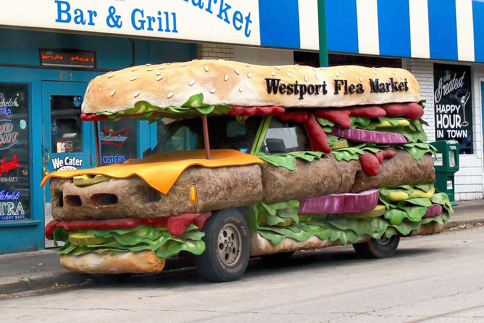 While not a food truck per se, this promotional bus for Westport Flea Market Bar and Grill is delicious. Created by master promotional vehicle artist Matt Targon, who had always dreamed of creating a burger car, the beefy, cheesy vehicle based on a Chevrolet S10 pickup roams the streets of Kansas City getting the name of this tasty burger joints out and about.