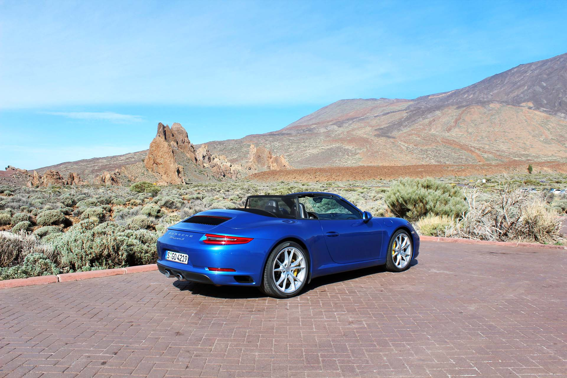 The 2017 Porsche 911 Carrera Cabriolet starts at $116,200. This is a Carrera S Cabriolet – base price $132,200. That volcano last erupted in 1798. If it happens again, the 911's roof goes up in less than 20 seconds.