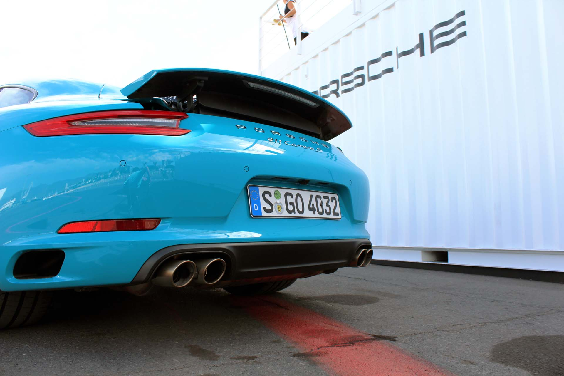 The 911's rear spoiler deploys at 120 km/h but will rise earlier if engine needs more cooling. This Carrera S has the standard exhaust system – the pair of wide spread dual-tips are the clue.