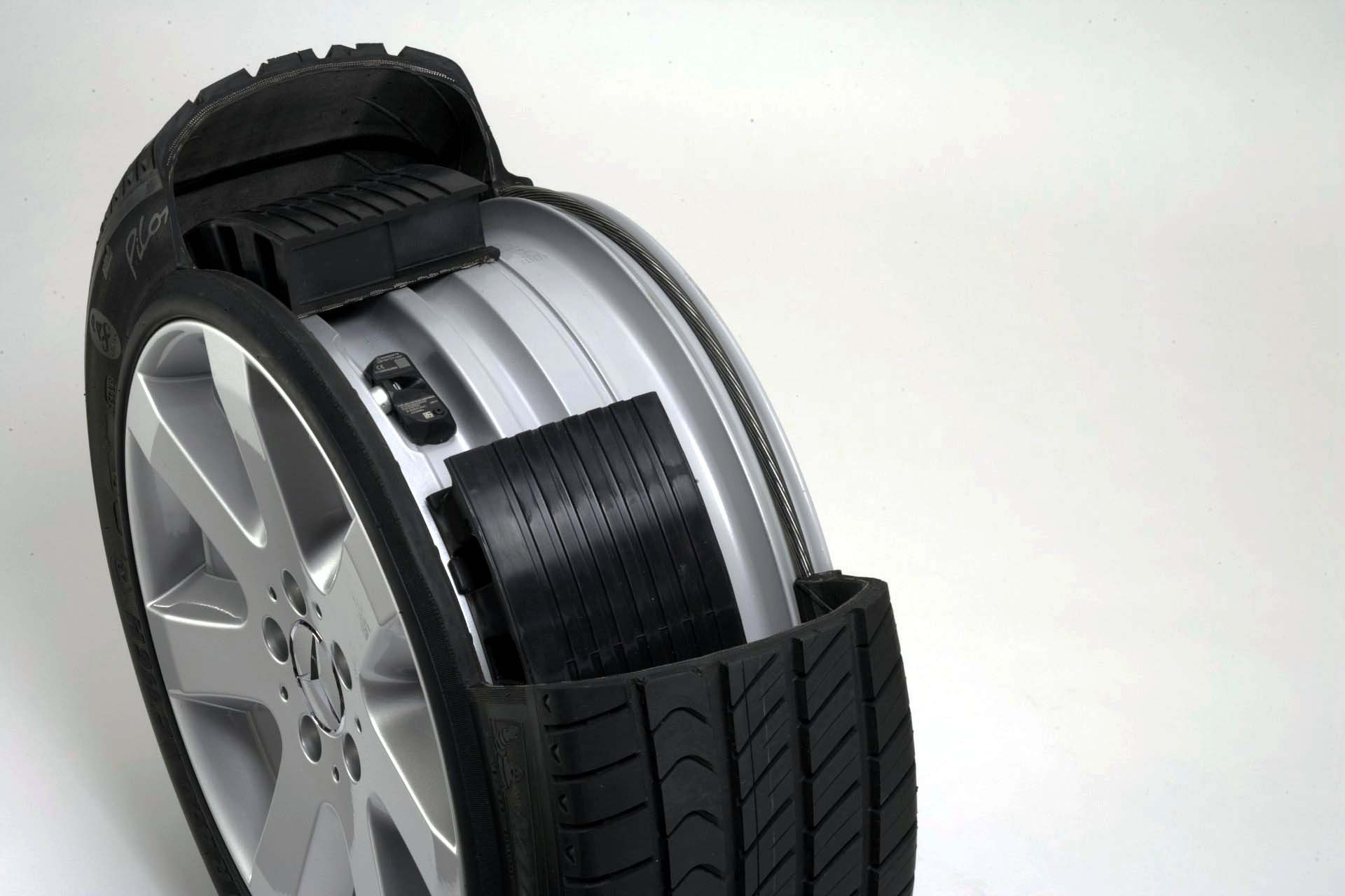 With run-flats, you can drive a limited distance at a limited speed after a loss of air, enabling you to limp your ride to a repair shop for a new tire, without having to install a spare. In this photo, we get a peek inside of a Bridgestone run-flat tire, and can see the support ring structure that holds the tire up if air is lost. Unfortunately, run-flats come with certain trade-offs, like a stiffer and noisier ride and higher replacement costs, while still being susceptible to sidewall flats.<br />