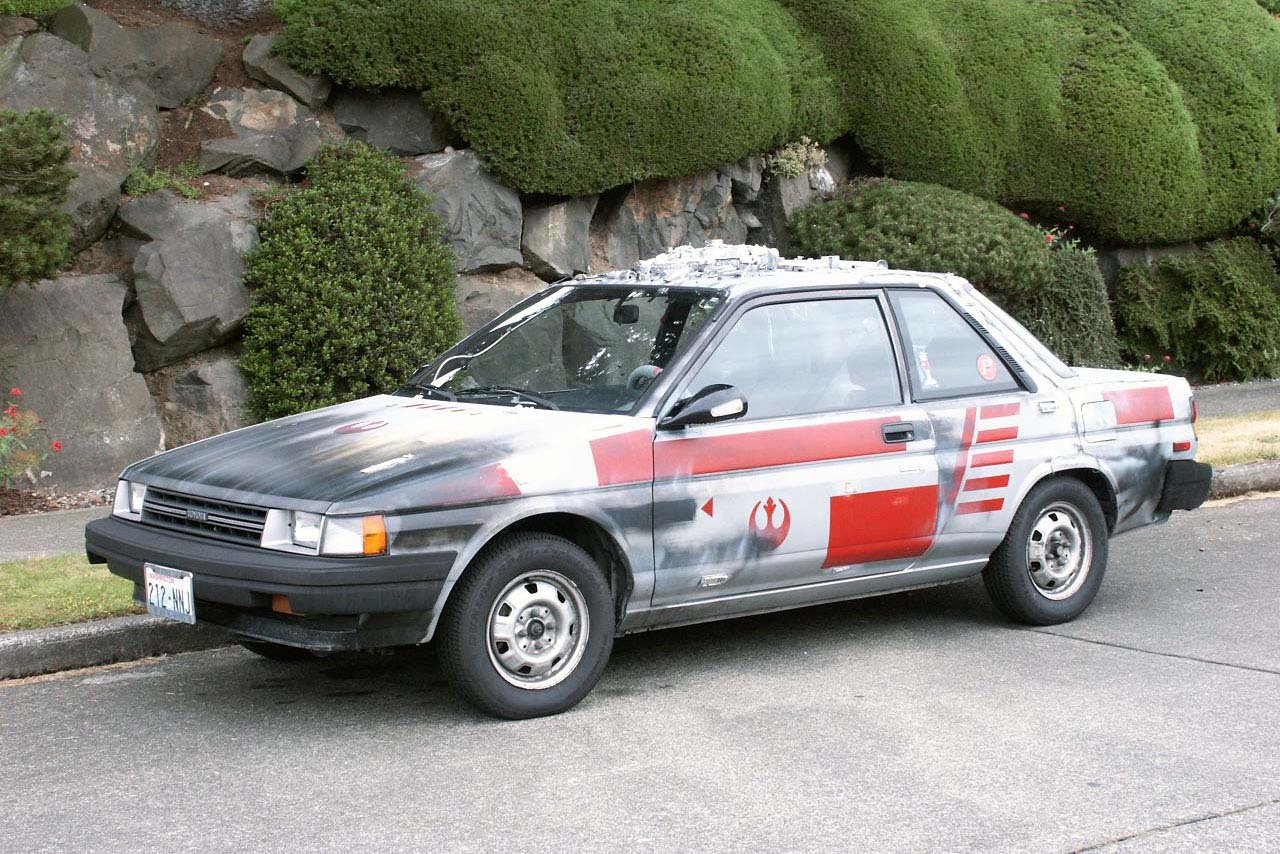 Katie Horn was bitten by the Star Wars bug in her early 20s and the end result was the decision to trick out her Toyota Tercel to look like it belonged in the Rebel Alliance's famed Red squadron. You might recognize the name of her car - Red 5 - as the call-sign used by Luke Skywalker in the first Star Wars movie when flying his X-Wing deep into the trenches of the original Death Star. Horn eventually formed her own online fighter wing, with close to 75 individuals working on their own Star Wars-themed automotive projects (including Obi-Shawn's various rides).