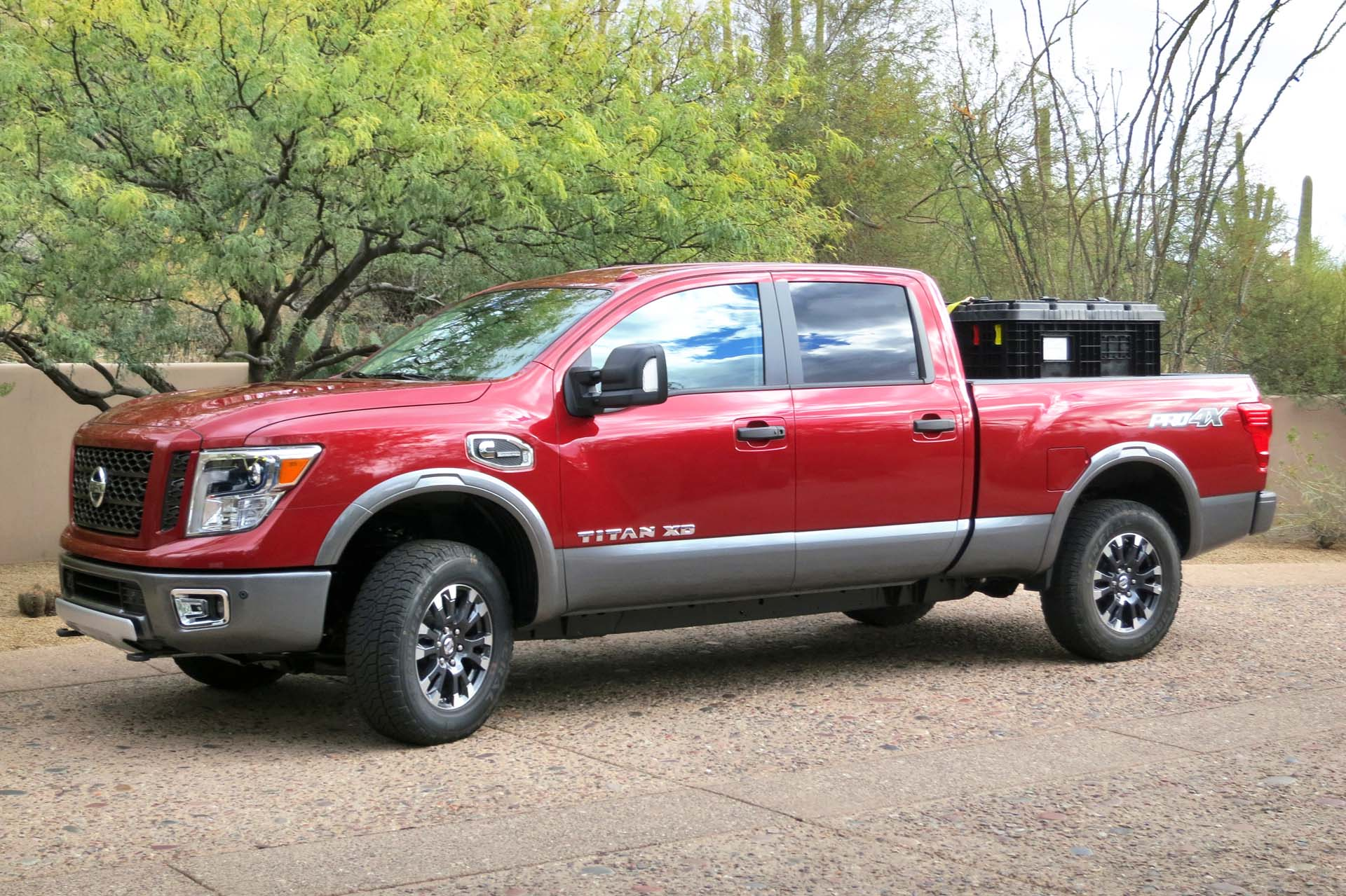 Heavy duty pickups are now posting big-rig tow ratings of just over 13,600 kg (30,000 lb). While the Titan XD's max towing capacity of 5,443 kg (12,300 lb) doesn't even come close to those numbers, at 100 lb more than the highest rated light duty truck (F-150), it does bridge the gap nicely. It also boasts such heavy duty features as engine braking, integrated trailer braking and sway control. Payload for the Crew Cab Titan XD 4x4 is 949 kg (2,093 lb).