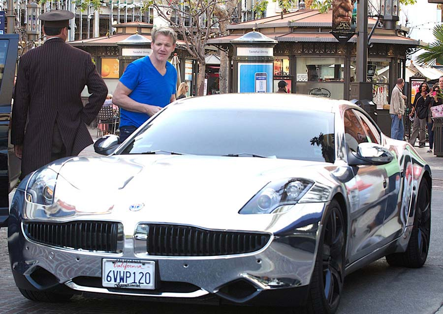 However, despite his love of Ferraris, Ramsay remains willing to admire other automobiles. Here, he checks out Justin Bieber's Fisker Karma. Similarly, you have to wonder if he can set his cordon bleu status aside and gaze longingly at Big Macs and cheeseburgers, while inside his soul he feels the tug of an unspeakable desire….