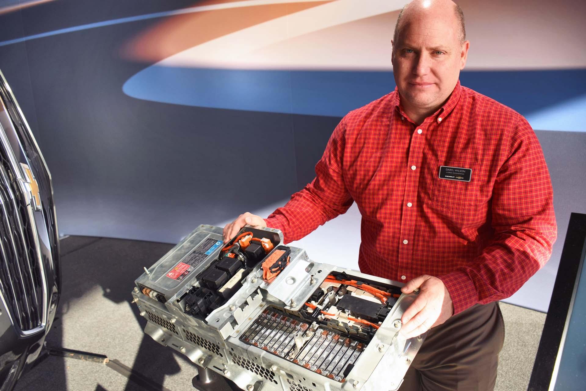 Malibu Hybrid Lead Development Engineer Daryl Wilson with battery pack