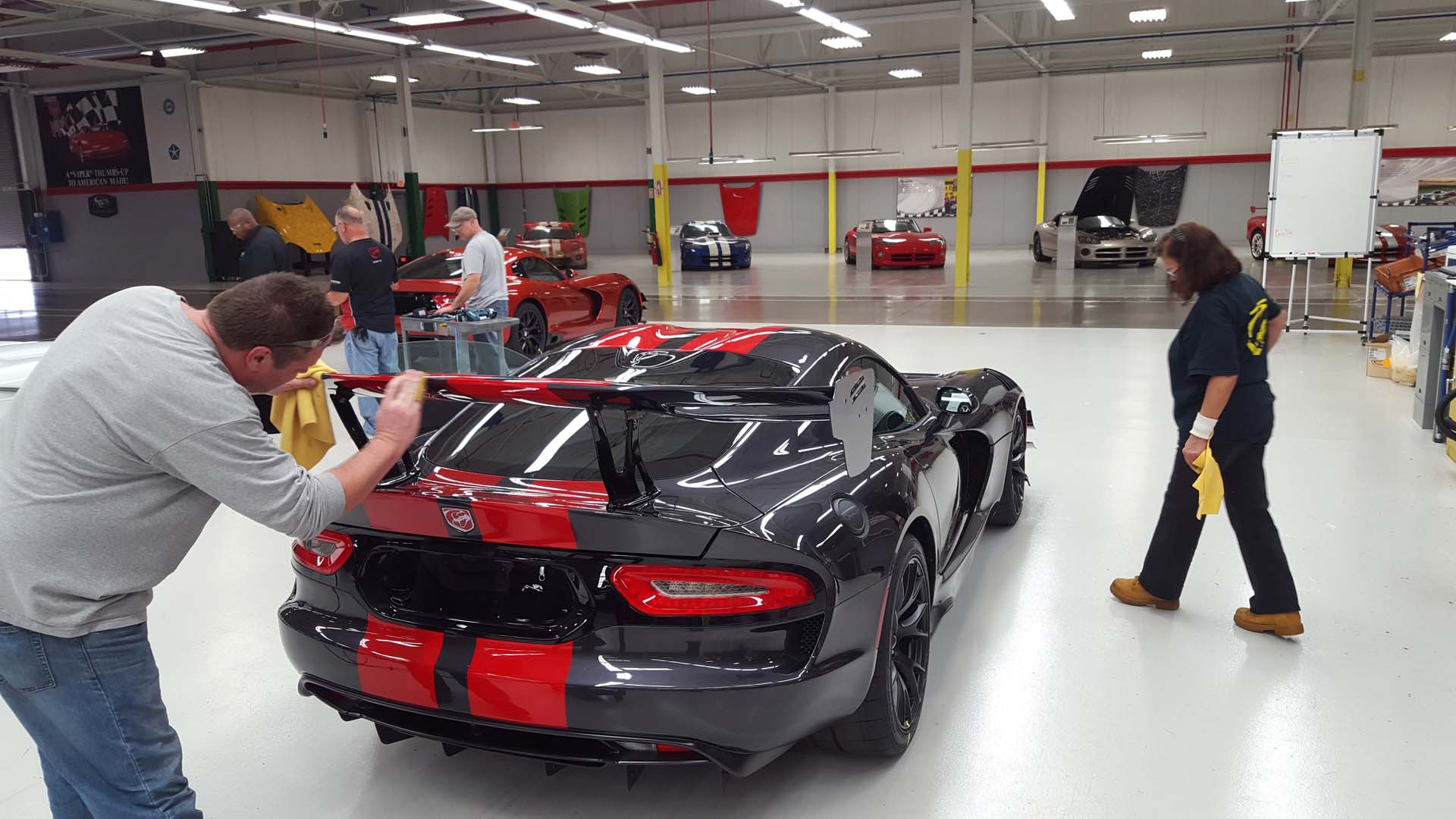 Every Viper is different, and they're all flawless. In this photo, Steven Showalter and Bonnie Marth give a new Viper ACR a close-up inspection. This pair works at Prefix, the company who paints and preps all of the Viper's body panels. They spend their day at Conner Avenue though, working under this flaw-revealing lighting and inspecting the paint and finish for any imperfections, no matter how small. In this photo, Showalter is making a final hand-buff of the rear spoiler, which he just finished re-buffing to remove some 'orange peel' in the paint.