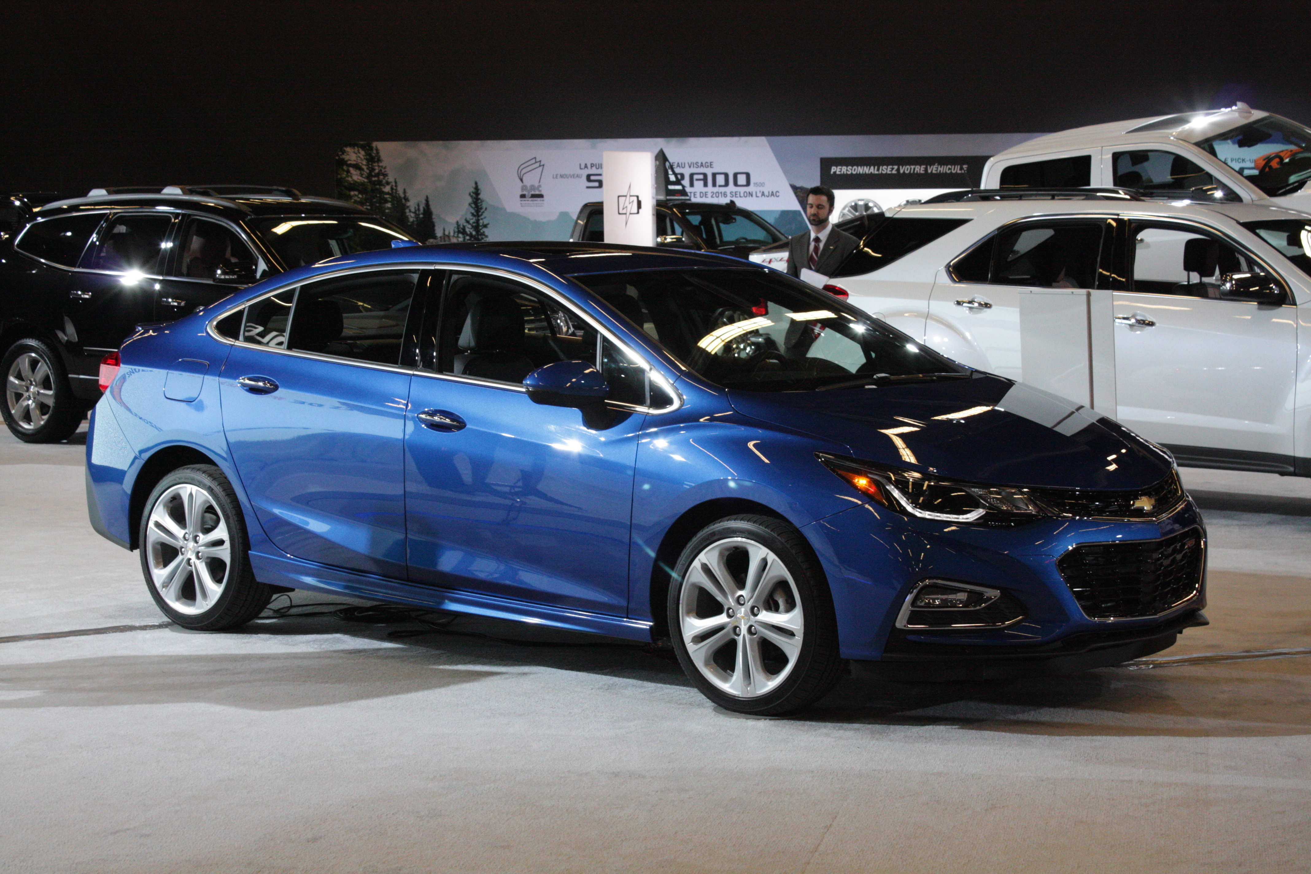 ... the Cruze compact sedan, wearing slick new styling and powered by a new 1.4L turbocharged engine...