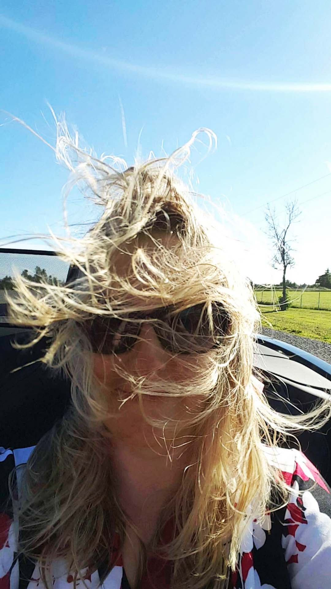 It's important to pack a hair tie for one's first trip in a convertible.