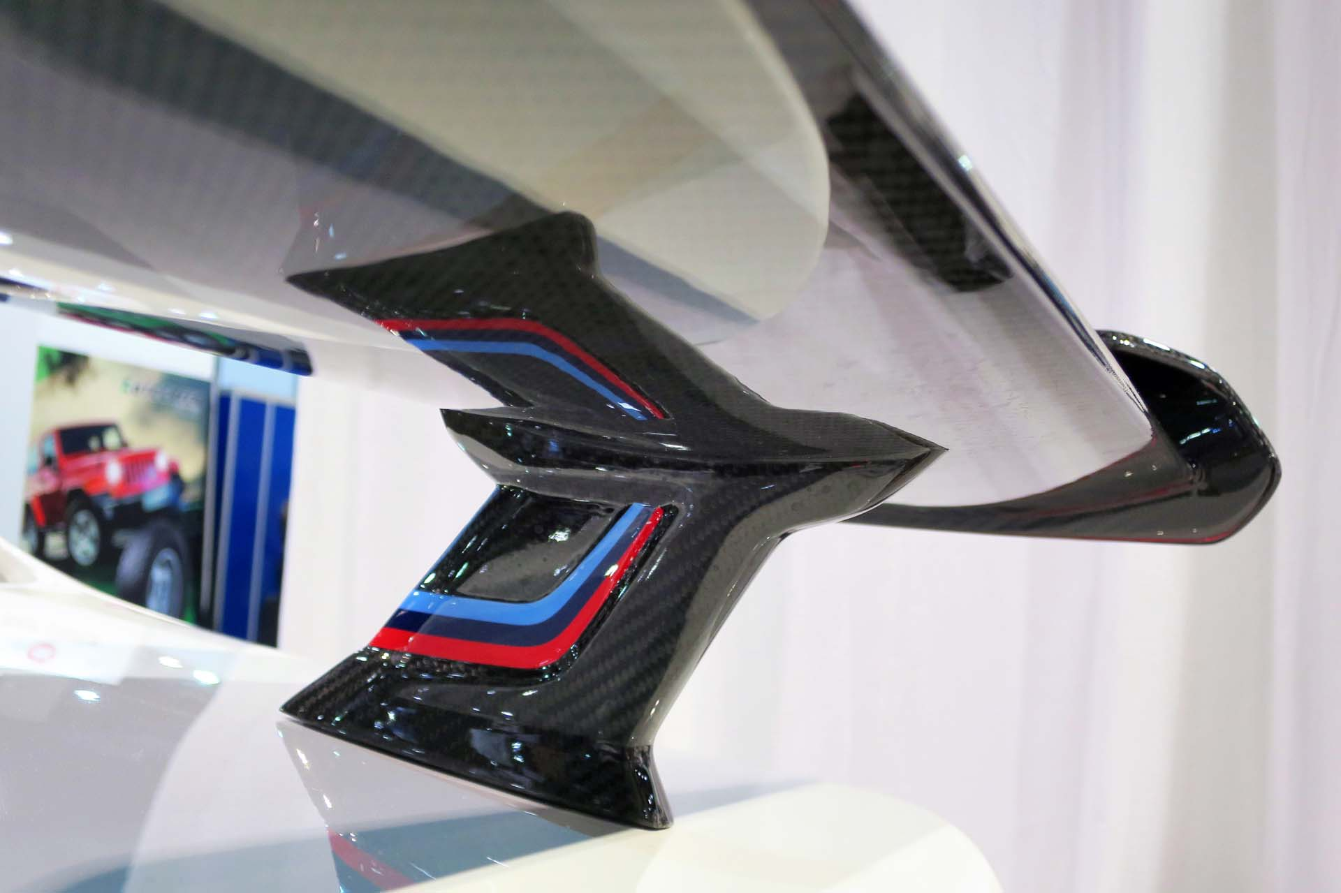 BMW offers a new Flow-Through wing for its M2, M3 and M4, hand-formed out of carbon fibre.