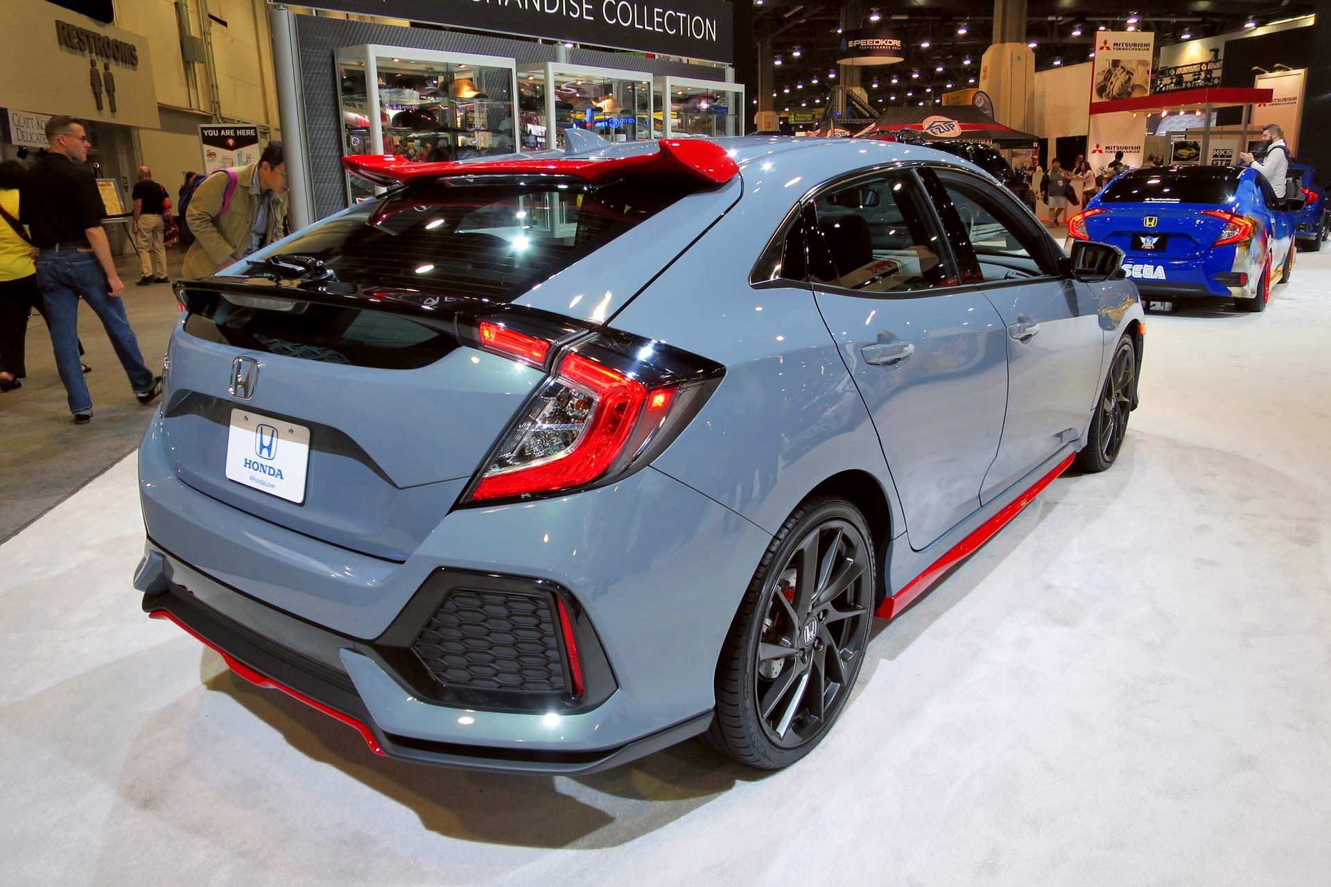 The Honda Civic Hatchback is displayed with all of its new optional accessories painted red.