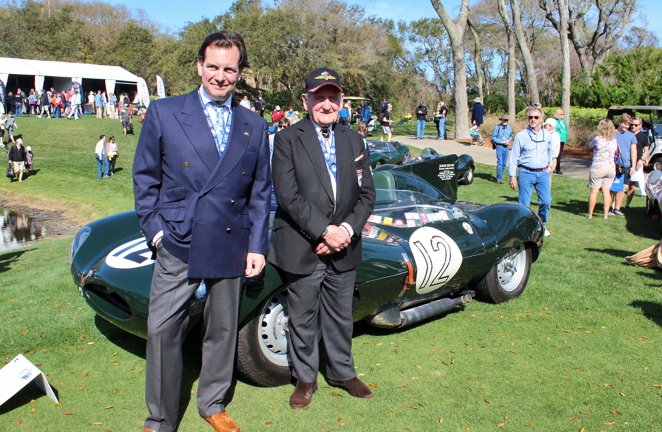 Michael Quinn (grandson of Jaguar founder Sir William Lyons) and Norman Dewis, Jaguar development driver in front of 1955 D-Type