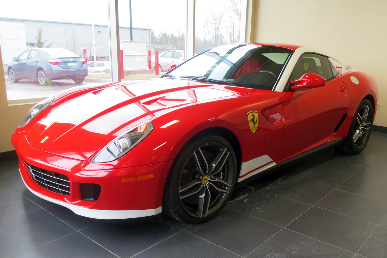 Sales rep Derek Poirier slips off the fabric cover and there it sits – one of the only forty Ferrari 599 GTB Alonso Edition 60F1 hyperformance coupes to roll from the gates of Ferrari's Maranello facilities.