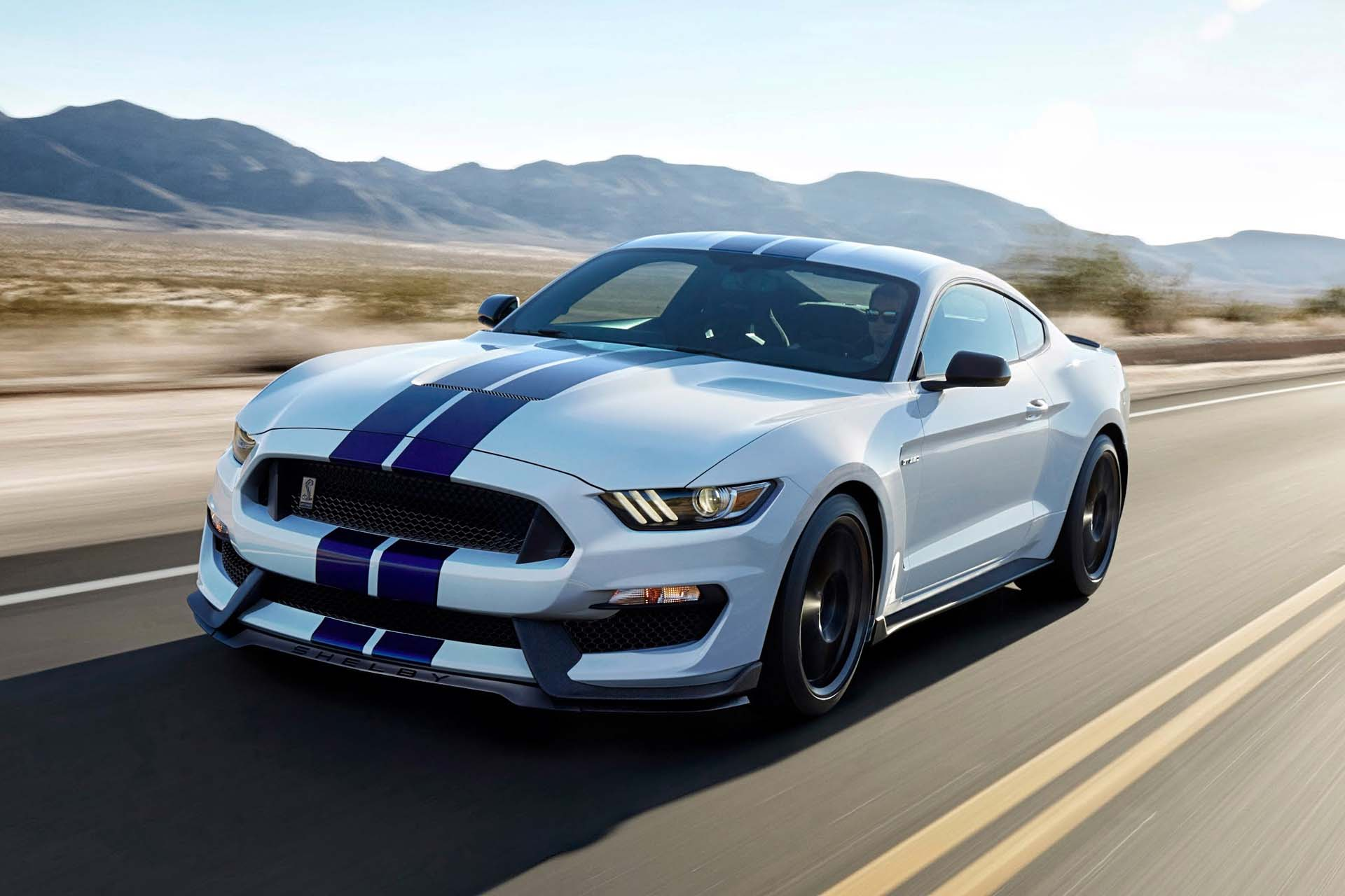 """Currently Ford's high horse is the GT350, any mention of which must legally include the phrase """"flat-plane crank."""" Basically, this thing's got muscle-car displacement with an engine design more commonly seen in Ferraris. Geez, that's really got to tick off Enzo. Expect the GT350 (and its racing version, the GT350R) to start showing up at racetracks soon, proving that the Mustang still knows how to run."""
