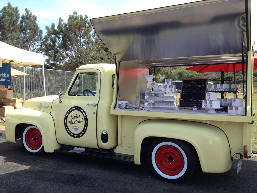 We also love us some vintage pickups, and this pie truck, Under the Crust, takes one of our favourites, a second-generation Ford F-Series (we think it's a '55 F-100…) and sets up a simple, classy display for some tasty pies atop its truck bed.