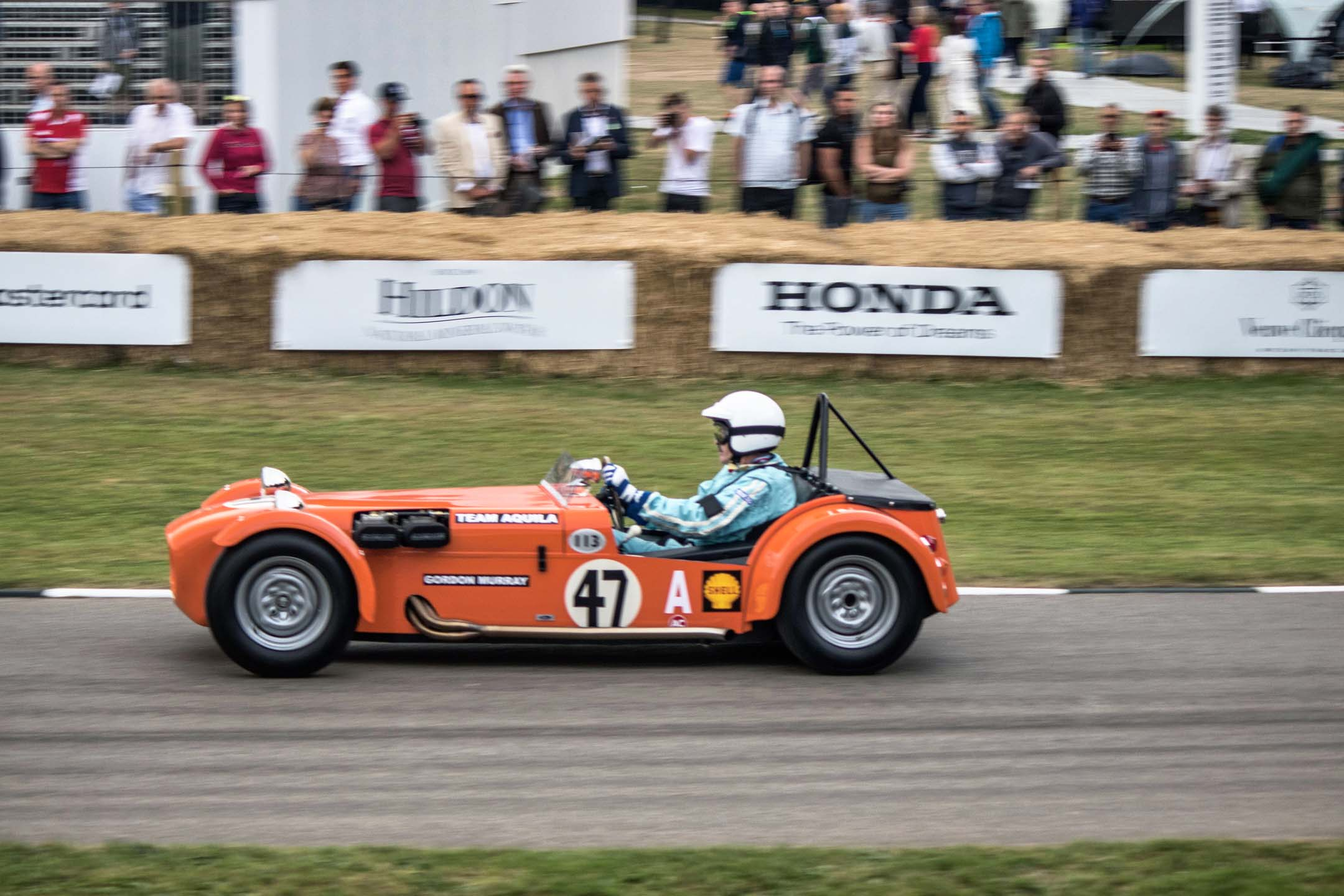 Noted car South African designer Gordon Murray goes up the hill in a Lotus Super Seven clone he built in his youth. Famous for many Brabham Formula One builds and the McLaren F1, Murray was surrounded by many of his own designs on the day.