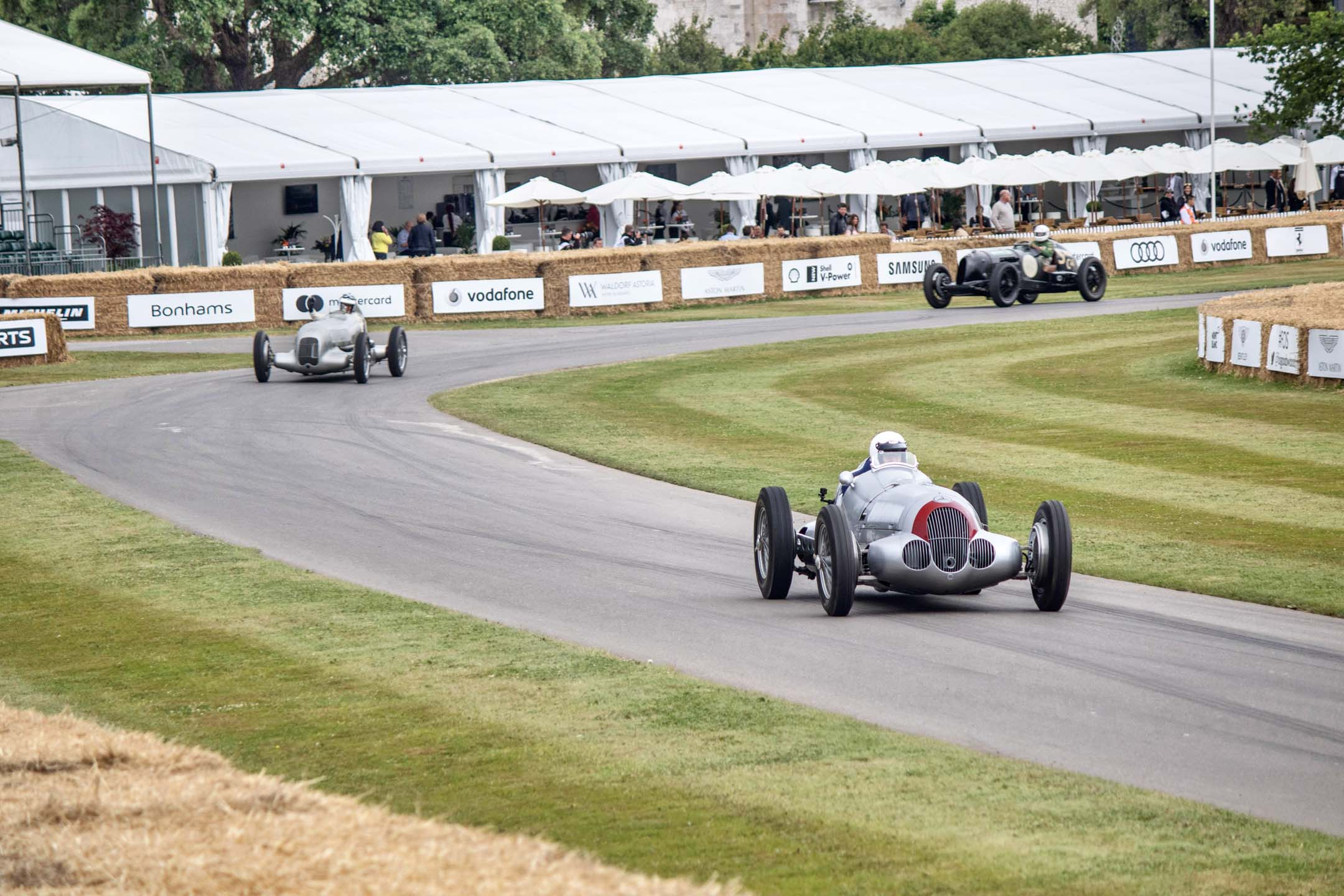 The Silver Arrows lead the pack down to the staging area. Astoundingly loud, complete with whining superchargers, this pair of vintage racers sounded like the grumpy ancestors of the Dodge Hellcat. The Mercedes Silver Arrows racing team dominated everyone, much like today's F1 team.