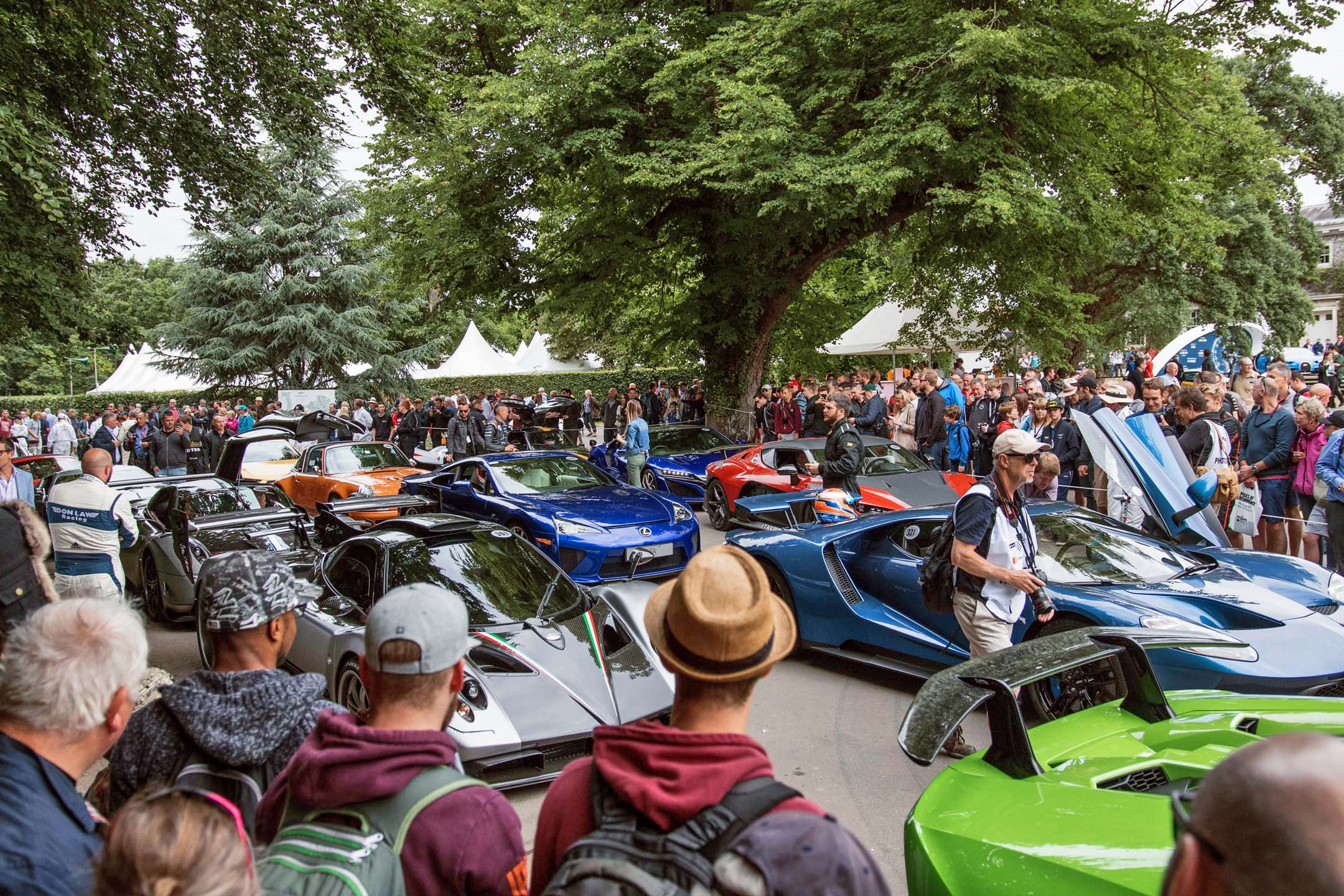 Gathered in the pre-staging paddock, all manner of supercars jostle for position. While a low time up the hill doesn't come with an official FIA trophy, it's certainly bragging rights for both the driver and the machine.