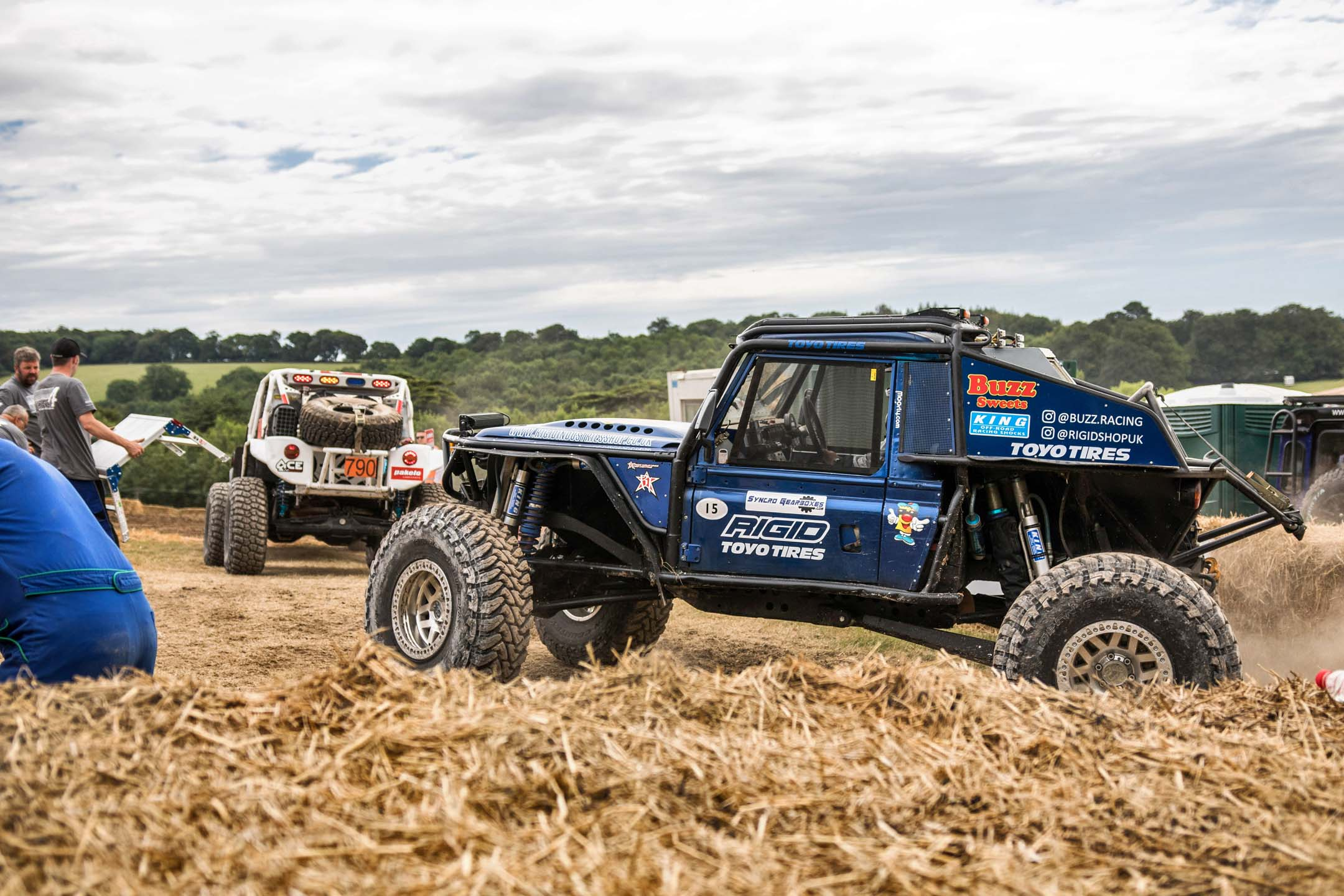 As Goodwood has expanded, the course has grown from just the tarmac climb to off-road and rally sections. Here, heavily modified machines make ready to head out onto the ruts and jumps of the off-road course.