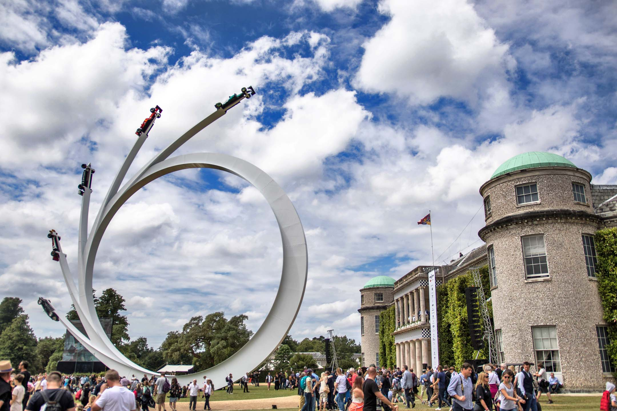 Towering into the sky outside Goodwood's stately living quarters, a quintet of F1 racing machines arc into the sky. The feature is erected each year, and new cars fixed onto it, depending on the theme of the show.